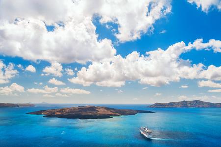 cruise liner: Cruise liner near the Greek Islands. Santorini island, Greece. Beautiful summer landscape Stock Photo
