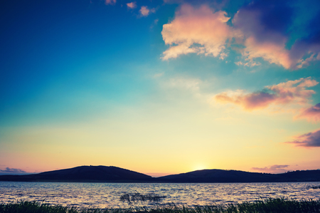 vintage landscape: Fantastic sunset on the lake. Beautiful summer landscape. Vintage effect