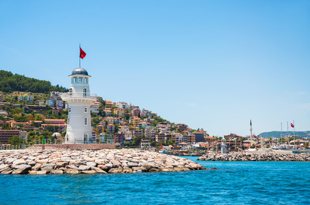 Lighthouse in the port of Alanya, Turkey.   Beautiful landscape with sea view.