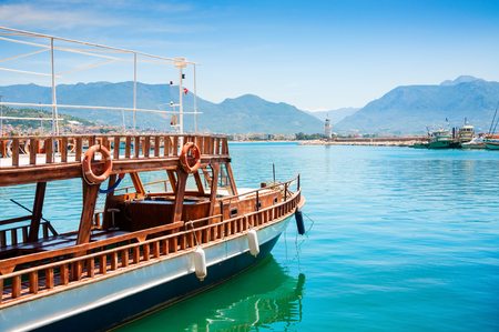 Tourist boat in the port of Alanya, Turkey. Beautiful views of sea and mountains