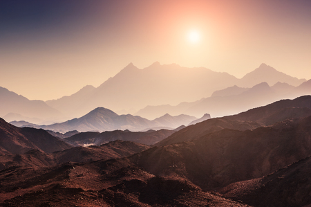 Fantastic landscape with mountains at sunset. Arabian desert, Egypt. Beautiful nature. Creative toning effect 写真素材