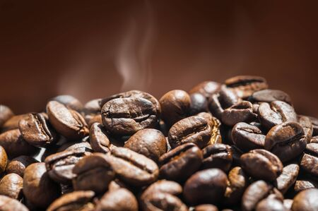 passion  ecology: Coffee beans on brown background, macro image with small depth of field.