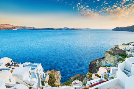 Beautiful view of the sea and islands at sunset. Oia town, Santorini island, Greece.