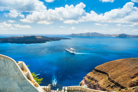 turquoise water: Beautiful view of the sea and islands. Blue sky and blue sea. Santorini island, Greece.