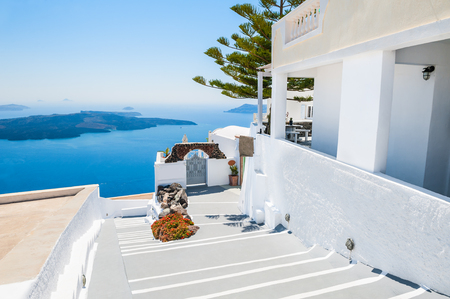 honeymoon suite: Luxury hotel with sea view. White architecture on Santorini island, Greece. Beautiful summer landscape