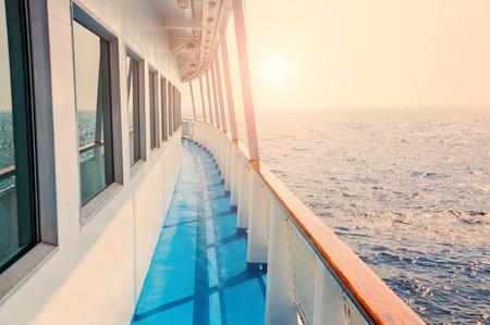 Cruise ship in sea at sunset. Beautiful summer seascape. Creative toning effect