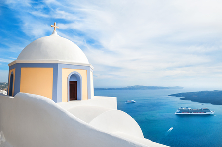 blue church: White architecture on Santorini island, Greece. Church in Fira town. Beautiful landscape with sea view