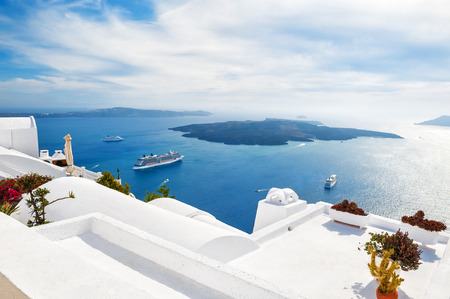 resort beach: Luxury hotel with sea view. White architecture on Santorini island, Greece. Beautiful seascape Stock Photo