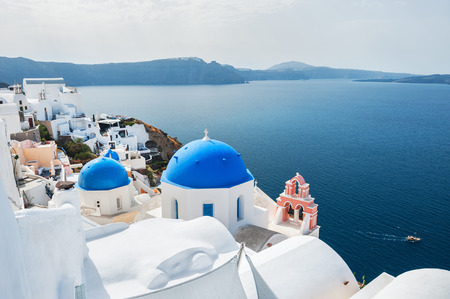 White architecture in Oia town, Santorini island, Greece. Beautiful landscape with sea view.