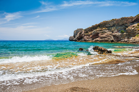 Beautiful wild beach with clear turquoise water and rocks. Malia, Crete island, Greece.