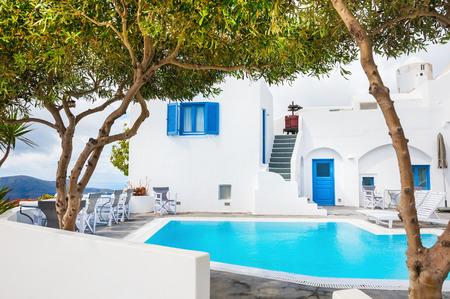 White architecture on Santorini island, Greece. Swimming pool in a hotel.