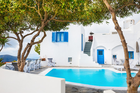 hotel lounge: White architecture on Santorini island, Greece. Swimming pool in a hotel.
