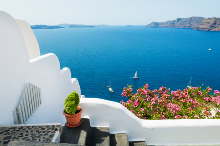 White architecture on Santorini island, Greece. Beautiful summer landscape with sea view.