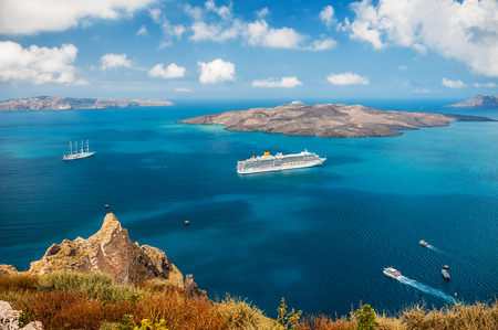 cruise liner: Cruise ship at sea near the Greek Islands. Santorini island, Greece