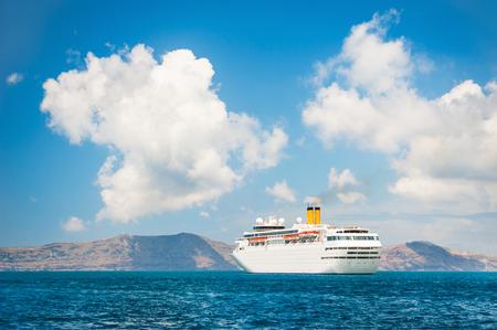 greek islands: Big cruise ship in the sea near the Greek Islands. Santorini island, Greece