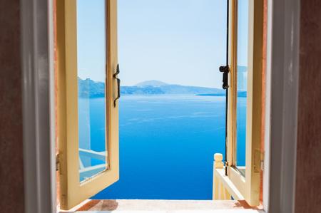 Open window with beautiful sea view. Santorini island, Greece