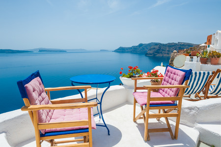 santorini: Beautiful terrace with sea view. White architecture on Santorini island, Greece. Stock Photo