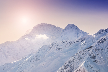 Winter snow-covered mountains at sunset. Beautiful winter landscape