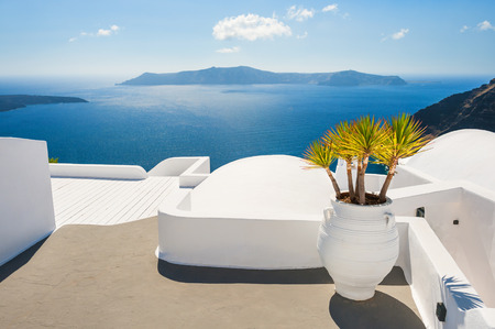 honeymoon suite: White architecture on Santorini island, Greece. Beautiful landscape with sea view. Stock Photo