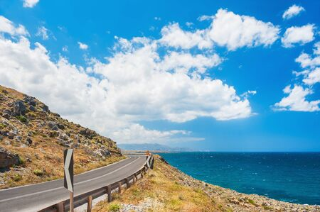 Road near the sea. Beautiful summer landscape with sea view. Crete island, Greece.