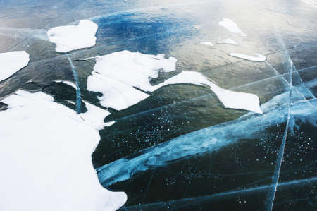 cracks in ice: Blue ice with cracks on the lake. Beautiful winter nature Stock Photo