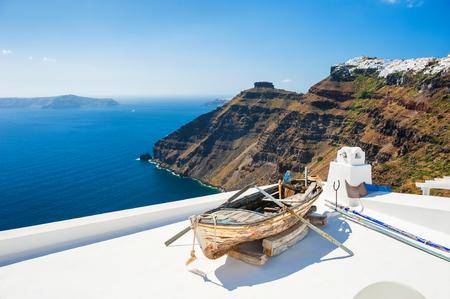 santorini: White architecture on Santorini island, Greece. Beautiful landscape with sea view. Stock Photo