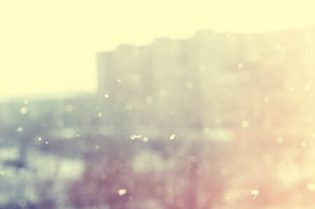 frozen winter: Snowfall in the city. Blurred winter background, vintage effect Stock Photo