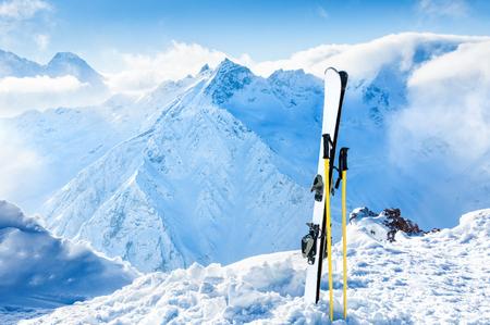 ski resort: Winter mountains and ski equipment in the snow. Skiing, ski resort, winter holidays. Stock Photo