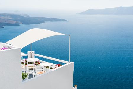 greece: White architecture on Santorini island, Greece. Beautiful landscape with sea view. Stock Photo