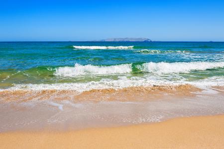 beach scene: Beautiful tropical beach with turquoise water and white sand. Crete island, Greece