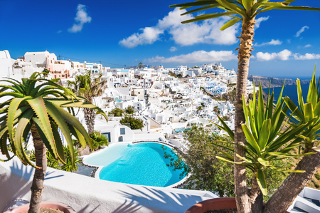 honeymoon suite: Panoramic view of Fira town. White architecture on Santorini island, Greece.