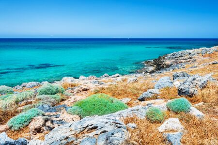 volcanic stones: Beautiful beach with turquoise water and volcanic stones. Crete island, Greece.