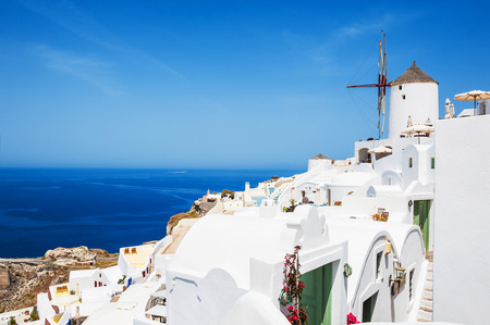 Panoramic view of Oia town, white architecture on Santorini island, Greece. Beautiful landscape with sea view
