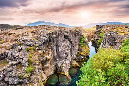 Cliffs and deep fissure in Thingvellir National Park, southern Iceland