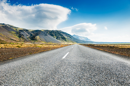 lenticular: Icelandic road with mountain view. Beautiful summer landscape, southern Iceland. Stock Photo