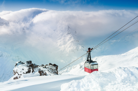 elbrus: Cable car on the ski resort. Elbrus, Caucasus, Russian Federation. Beautiful winter landscape with snow-covered mountains.