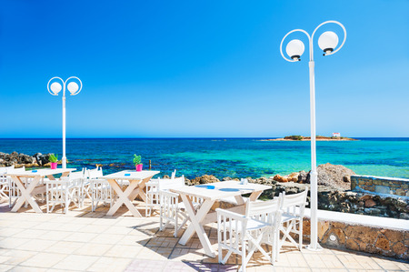 Beautiful tropical beach with turquoise water. Cafe on the beach. Malia, Crete island, Greece.