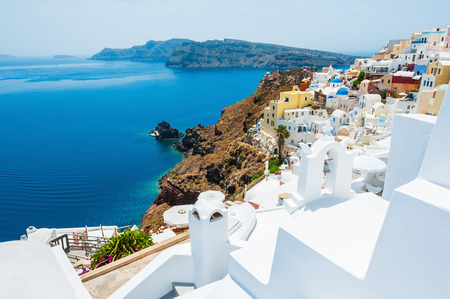 greek island: Panoramic view of Oia town, Santorini island, Greece. Beautiful landscape with sea view.