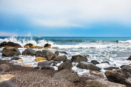 Waves on the wild seacoast. Vlychada beach, Santorini island, Greece