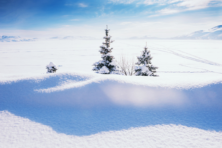 Snow covered lake after snowfall. Beautiful winter landscape.