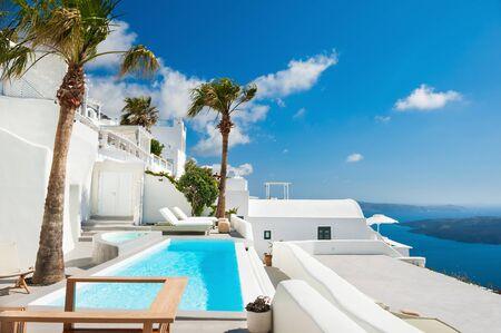 honeymoon suite: White architecture on Santorini island, Greece. Beautiful landscape with sea view