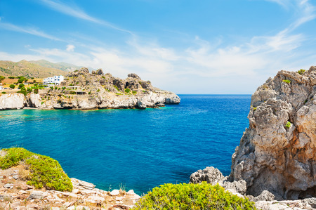 Beautiful beach with clear turquoise water and cliffs. Crete island, Greece.