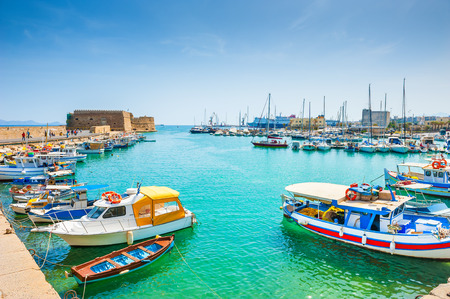 Old venetian harbor with boats in Heraklion, Crete island, Greece Stock Photo