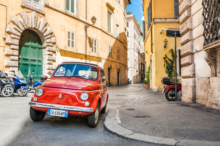 fiat: Rome, Italy - May 2, 2016. Red vintage Fiat Nuova 500 parked in the old street in Rome. Editorial