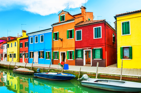 Scenic canal with colorful houses in Burano island near Venice, Italy