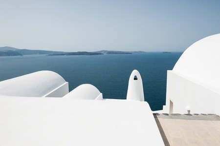 impression: White architecture on Santorini island, Greece. Beautiful landscape with sea view