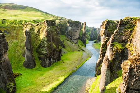 Fjadrargljufur canyon with river and big rocks. South Iceland