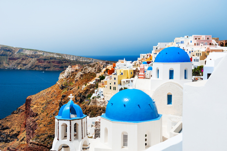 White church with blue domes on Santorini island, Greece. Beautiful landscape, sea view Stock Photo