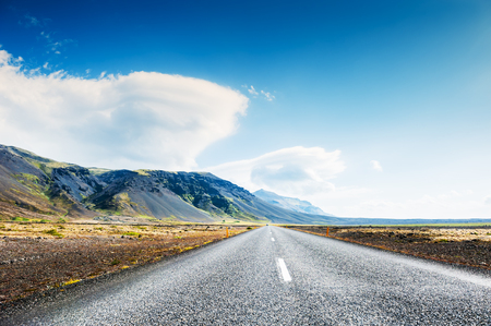 lenticular: Road in the lava fields and mountains in Iceland. Beautiful summer landscape Stock Photo