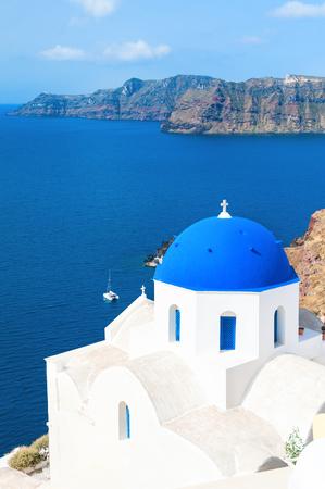 Church with blue domes in Santorini island, Greece. Beautiful landscape, sea view Stock Photo